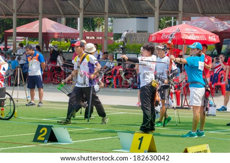 BANGKOK ,THAILAND - MARCH 15: Two teams of archers shoot out for a best point at 1st Asian Archery Grand Prix 2014 , on March 15, 2014 in Bangkok, Thailand.