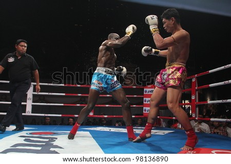 BANGKOK, THAILAND- MARCH 16 : Unidentified athletes compete in World Amateur Muaythai Champioships 2012. on March 16, 2012 at National Stadium, Bangkok, Thailand