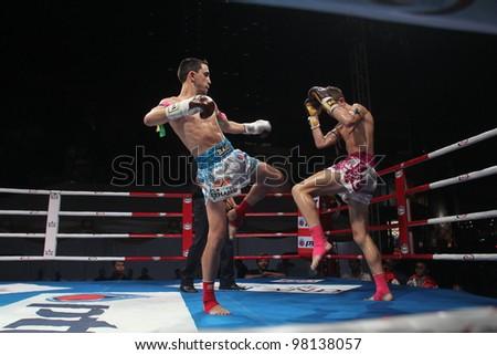 BANGKOK, THAILAND- MARCH 16 : Unidentified athletes compete in World Amateur Muaythai Champioships 2012. on March 16, 2012 at National Stadium, Bangkok, Thailand - stock photo