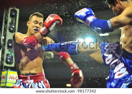 BANGKOK, THAILAND- MARCH 21 : Unidentified athletes compete in World Amateur Muaythai Champioships 2012. on March 21, 2012 at National Stadium, Bangkok, Thailand