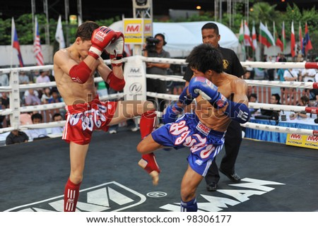 BANGKOK, THAILAND- MARCH 22 : Unidentified athletes compete in World Amateur Muaythai Champioships 2012. on March 22, 2012 at National Stadium, Bangkok, Thailand - stock photo