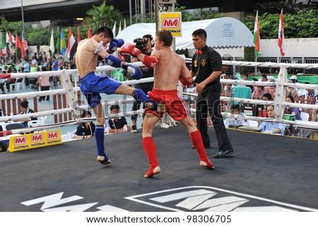 BANGKOK, THAILAND- MARCH 22 : Unidentified athletes compete in World Amateur Muaythai Champioships 2012. on March 22, 2012 at National Stadium, Bangkok, Thailand