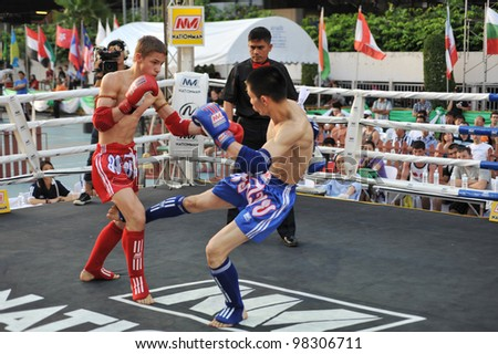 BANGKOK, THAILAND- MARCH 22 : Unidentified athletes compete in World Amateur Muaythai Champioships 2012. on March 22, 2012 at National Stadium, Bangkok, Thailand