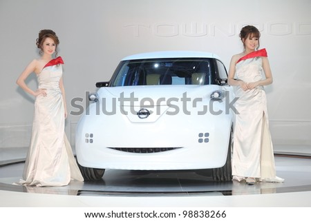 BANGKOK, THAILAND- MARCH 27: Unidentified female presenters with Nissan eco car on display at  the Bangkok International Motorshow 2012 on March 27, 2012 in Bangkok,Thailand - stock photo