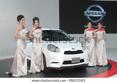 BANGKOK, THAILAND- MARCH 27: Unidentified female presenters with Nissan nismo eco car on display at  the Bangkok International Motorshow 2012 on March 27, 2012 in Bangkok,Thailand