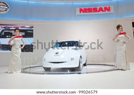 BANGKOK, THAILAND - MARCH 31: Unidentified females presenter with Nissan townpod car at Nissan booth in The 33rd Bangkok International Motor Show 2012 on March 31, 2012 in Bangkok, Thailand.