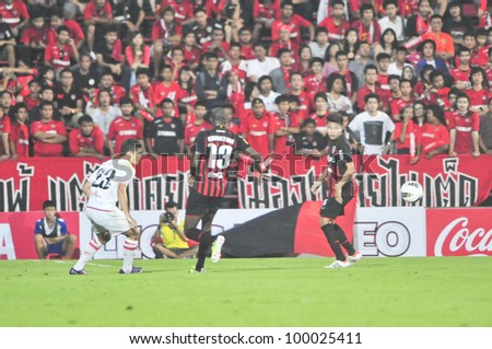 BANGKOK THAILAND - MARCH 17 : Unidentified player in Thai Premier League (TPL) between SCG Muangthong Utd. (red) vs BEC Tero (White) on March 17, 2012 in SCG Stadium in Bangkok Thailand