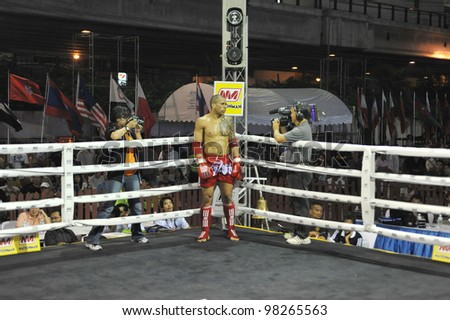 BANGKOK, THAILAND- MARCH 22 : W.Losta (red) VS C.Benzaquen in World Amateur Muaythai Champioships 2012. on March 22, 2012 at National Stadium, Bangkok, Thailand - stock photo