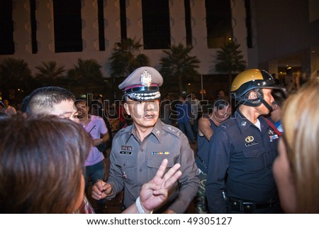 BANGKOK, THAILAND - MAY 6: Crowd and vendors of Patpong night market demonstrate as police confiscate their fake goods May 6, 2009 in Bangkok. The area is famous for selling fake goods.
