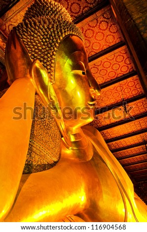 BANGKOK, THAILAND - MAY 24:   Details of the Reclining Buddha statue at the Wat Pho temple  on May 24, 2012  in Wat Pho temple, Bangkok,Thailand.  The reclining Buddha  is 15m high and 43m long.