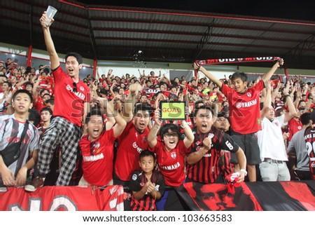 BANGKOK, THAILAND - MAY 28 : Fan Club of Muangtong in Thai Premier League (TPL) between Muangtong UTD. (R) VS Chonburi FC (B) at SCG stadium on May 28, 2012 in Bangkok,Thailand. - stock photo