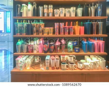 BANGKOK, THAILAND - MAY 13, 2018 - Starbucks Coffee inside display sale mugs cups at coffee shop in Bangkok, photo by smartphone #1089562670