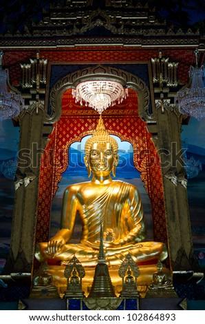 BANGKOK, THAILAND - MAY 10: The main hall of Wat Thardtong with golden Buddha statue on May 10, 2012. Wat Thardtong is a famous temple built in ancient Siam Kingdom.