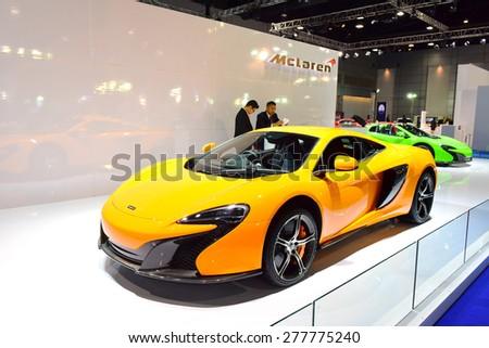 BANGKOK THAILAND - MAY 09 :  Yellow Mclaren Super car showing on exhibit space agency in Bangkok Thailand on 09 May 2015