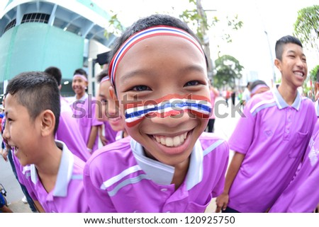 BANGKOK,THAILAND-NO VEMBER 11: Unidentified of Thailand paint A flag on the face. supporters during the FIFA Futsal World Cup between Thailand and Spain at Nimibutr Stadium on Nov11,2012 in,Thailand. - stock photo