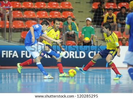 BANGKOK, THAILAND-NOV 18:Alex Merlim of Italy (b) in action during the FIFA Futsal World Cup between Italy and Colombia at Indoor Stadium Huamark on Nov18,2012 in Bangkok,Thailand.
