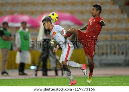 BANGKOK THAILAND-NOV 24:Au Van Hoan of Vietnam (white) in action  during the AFF Suzuki Cup between Vietnam and Myanmar at Rajamangala stadium on Nov24, 2012 in Bangkok,Thailand.