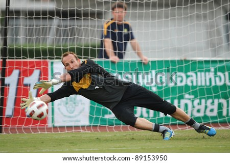 BANGKOK THAILAND - NOV 15:Australian goal keeper Mark Schwazer in action during The FIFA WORLD CUP 2014 between Thailand(B) and Australia (Y) at Supachalasai Stadium on Nov 15, 2011 Bangkok, Thailand.