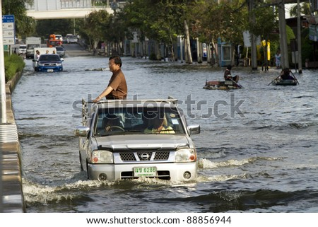 BANGKOK, THAILAND - NOV 12: Commuter transported on the big truck after the city was flooded on November 12, 2011 in Bangkok, Thailand.