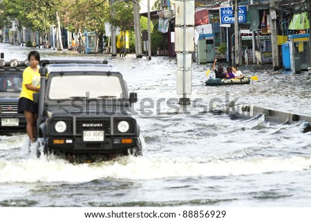BANGKOK, THAILAND - NOV 12: Commuter transported on the big truck only after the city was flooded on November 12, 2011 in Bangkok, Thailand.