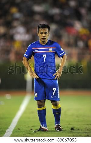 BANGKOK THAILAND - NOV 15: D.Thonglao of Thailand in action during The FIFA WORLD CUP 2014 between Thailand(B) and Australia (Y) at Supachalasai Stadium on Nov 15, 2011 Bangkok, Thailand.