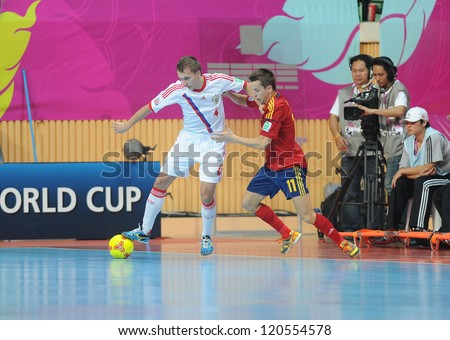 BANGKOK, THAILAND -NOV 14:Dmitrii Prudnikov of Russia (w) in action during the FIFA Futsal World Cup Quarterfinal Round between Spain and Russia at Nimibutr Stadium on Nov14,2012 in Bangkok, Thailand.