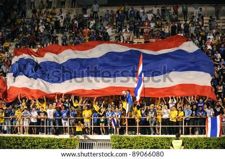 BANGKOK THAILAND - NOV 15:Fanclub of Thailand in action during The FIFA WORLD CUP 2014 between Thailand(B) and Australia (Y) at Supachalasai Stadium on Nov 15, 2011 Bangkok, Thailand. - stock photo