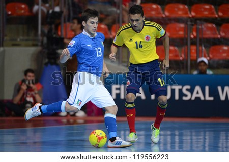 BANGKOK,THAILAND-NOV18:Gabriel Lima (blue) of Italy control the ball during the FIFA Futsal World Cup  between Italy and Colombia at Indoor Stadium Huamark on Nov18,2012 in,Thailand.