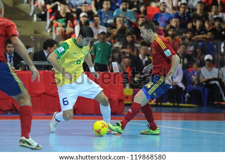 BANGKOK, THAILAND - NOV 18 : Gabriel of Brazil during action in FIFA Futsal World Cup thailand 2012 Between Spain (R) VS Brazil (Y) on November 18, 2012 at Indoor Stadium Huamark in Bangkok Thailand.