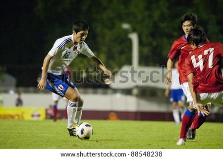 BANGKOK, THAILAND - NOV 11 : K.Naoki (L) in action during AFC U-19 Championship 2012 between Korea Republic (R) and Japan (W) at Debhatsadin Stadium on November 11, 2011 in Bangkok, Thailand