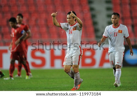 BANGKOK THAILAND-NOV 24:Le Tan Tai of Vietnam#14 (white)  celebrates after scoring during the AFF Suzuki Cup between Vietnam and Myanmar at Rajamangala stadium on Nov24, 2012 in Bangkok,Thailand.