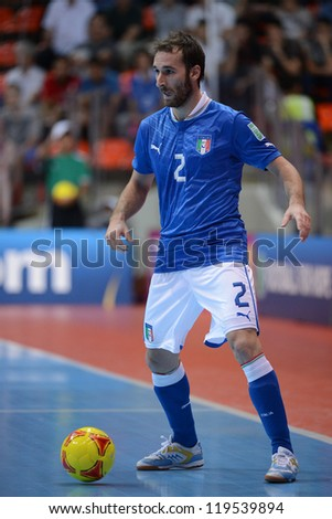 BANGKOK,THAILAND-NOV18:Marco Ercolessi of Italy control the ball during the FIFA Futsal World Cup 3rd/4th Playoff match between Italy and Colombia at Indoor Stadium Huamark on Nov18,2012 in,Thailand.