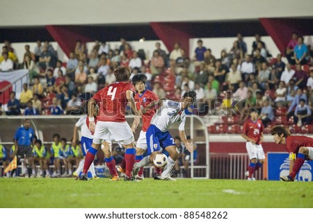 BANGKOK, THAILAND - NOV 11 : N.Gakuto (R) in action during AFC U-19 Championship 2012 between Korea Republic (R) and Japan (W) at Debhatsadin Stadium on November 11, 2011 in Bangkok, Thailand