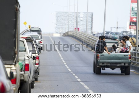 BANGKOK, THAILAND - NOV 12: People traveling by truck after the city was flooded on November 12, 2011 in Bangkok, Thailand.