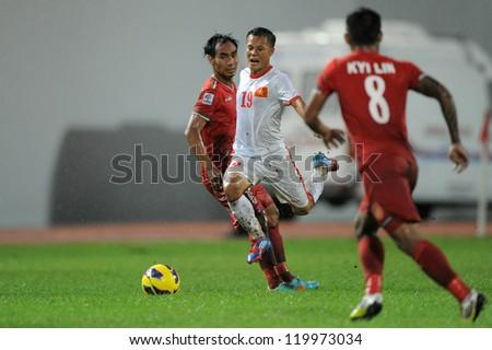 BANGKOK THAILAND-NOV 24:Phm Thanh Luong of Vietnam (white) in action  during the AFF Suzuki Cup between Vietnam and Myanmar at Rajamangala stadium on Nov24, 2012 in Bangkok,Thailand.