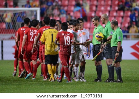 BANGKOK THAILAND-NOV 24:Players of Vietnam (white) and Players of Myanmar (red)Shake hands during the AFF Suzuki Cup between Vietnam and Myanmar  at Rajamangala stadium on Nov24,2012 in,Thailand.