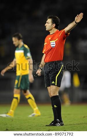 BANGKOK THAILAND - NOV 15: Referee Saeid Mozaffari of Iran in action during The FIFA WORLD CUP 2014 between Thailand(B) and Australia (Y) at Supachalasai Stadium on Nov 15, 2011 Bangkok, Thailand.