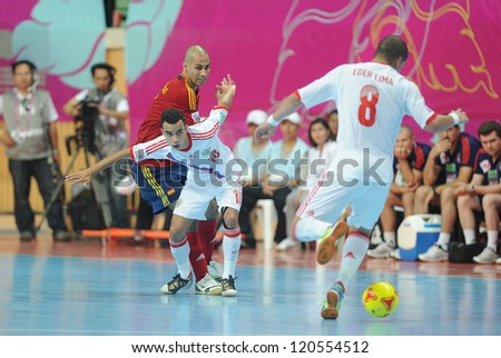 BANGKOK, THAILAND - NOV 14:Robinho of Russia (w) in action during the FIFA Futsal World Cup Quarterfinal Round between Spain and Russia at Nimibutr Stadium on Nov14,2012 in Bangkok, Thailand.