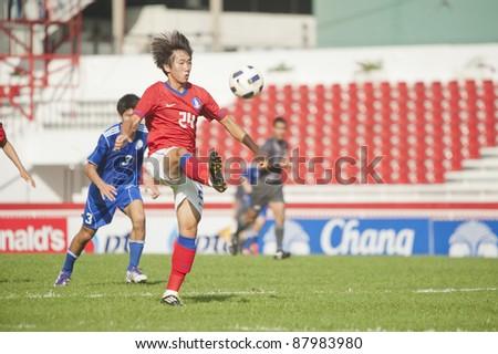 BANGKOK, THAILAND - NOV 2 : S.Sangwoo (R) in action during AFC U-19 Championship 2012 between Korea Republic (R) and Guam (B) at Debhatsadin Stadium on November 2, 2011 in Bangkok, Thailand