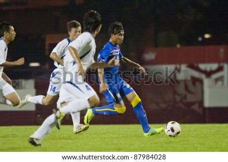 BANGKOK, THAILAND - NOV 2 : T.Puangjan (B) in action during AFC U-19 Championship 2012 between Korea Republic (R) and Guam (B) at Debhatsadin Stadium on November 2, 2011 in Bangkok, Thailand
