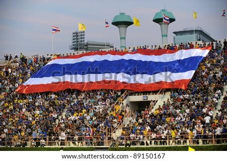 BANGKOK THAILAND - NOV 15 Thailand fans cheer their team during The FIFA WORLD CUP 2014 between Thailand(B) and Australia (Y) at Supachalasai Stadium on Nov 15, 2011 Bangkok, Thailand. - stock photo