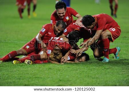 BANGKOK, THAILAND - NOV 24:Thailand player  celebrates after scoring during the AFF SUZUKI CUP 2012 between Thaialand and Philippines at Rajamangkala stadium on Nov 24,2012 in Thailand.