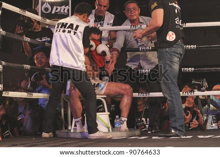 BANGKOK, THAILAND- NOV 27 : Unidentified boxers compete in Thai Fight:Muay Thai. World's Unrivalled Fight on November 27, 2011 at Convention Hall, Imperial World Samrong, Samutprakan, Thailand