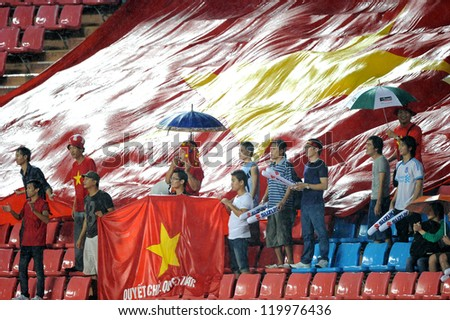 BANGKOK THAILAND-NOV 24:Unidentified of Vietnam Flag supporters during the AFF Suzuki Cup between Vietnam and Myanmar at Rajamangala stadium on Nov24, 2012 in Bangkok,Thailand.