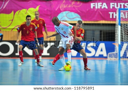 BANGKOK, THAILAND - NOV 14 : Unidentified players in FIFA Futsal World Cup, Quarter-Final match between Spain (R) and Russia (W) at Nimibutr Stadium on November 14, 2012 in Bangkok, Thailand.