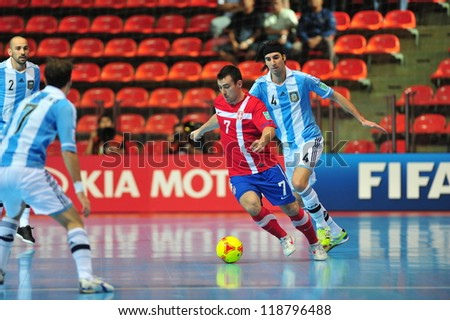 BANGKOK, THAILAND - NOV 12 : Unidentified players in FIFA Futsal World Cup Round of 16 match between Serbia (R) and Argentina (B) at Indoor Stadium Huamark on November 12, 2012 in Bangkok, Thailand