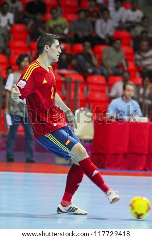 BANGKOK, THAILAND - NOV 2 : Unidentified players in FIFA Futsal World Cup thailand 2012 Between Spain (R) VS Iran (W) on November 2, 2012 at Indoor Stadium Huamark in Bangkok Thailand. - stock photo