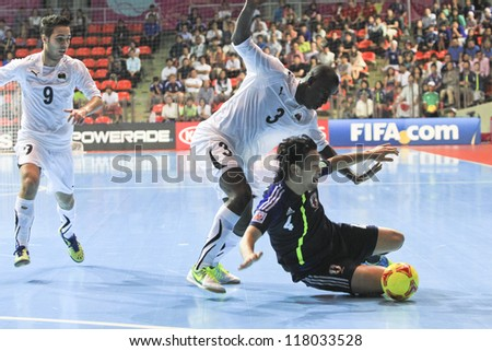 BANGKOK, THAILAND - NOV 7 : Unidentified players in the FIFA Futsal World Cup Group C match between Japan and Libya at Indoor Stadium Huamark on November 7, 2012 in Bangkok, Thailand.