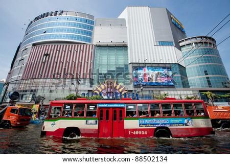 BANGKOK, THAILAND - NOVEMBER 9: A city bus makes its way through a major flooded street in the Phahonyothin road on November 9, 2011 Bangkok, Thailand.
