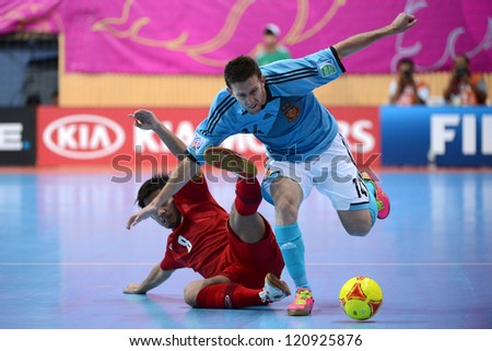 BANGKOK, THAILAND - NOVEMBER 11: Alemao of Spain (blue) runs with the ball during the FIFA Futsal World Cup  between Thailand and Spain at Nimibutr Stadium on Nov11, 2012 in Bangkok,Thailand.